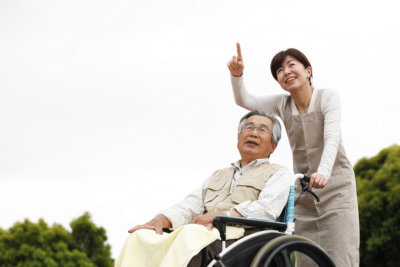portrait of senior in a wheelchair and caregiver