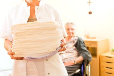 female caregiver holding towels