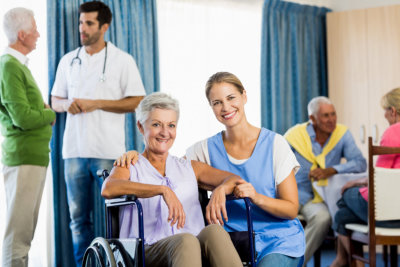 portrait of seniors and caregivers at home care